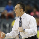 FILE - In this March 31, 2013 file photo, Florida head coach Billy Donovan reacts during a basketball game against Michigan at the NCAA college basketball tournament in Arlington, Texas. Donovan's roster is loaded with transfers, including the recent additions of South Florida center John Egbunu and Michigan forward Jon Horford. Donovan now has seven players who started elsewhere, a strategy that is fast becoming his trademark. (AP Photo/David J. Phillip, File)
