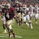Florida State running back Chris Thompson (4) dashes to a 24-yard touchdown during the fourth quarter of an NCAA college football game against Clemson on Saturday, Sept. 22, 2012, in Tallahassee, Fla. (AP Photo/Phil Sears)