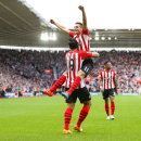 Southampton's Graziano Pelle, below, celebrates his team's fifth goal of the game with teammate Dusan Tadic during their English Premier League soccer match against Sunderland at St. Mary's Stadium, Southampton, England, Saturday, Oct. 18, 2014