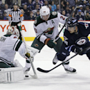 Minnesota Wild's goaltender Niklas Backstrom (32) stops the shot from Winnipeg Jets' Devin Setoguchi (40) as Wild's Ryan Suter (20) forces Setoguchi off the rebound during the second period of an NHL game in Winnipeg, Manitoba, Saturday, Nov. 23, 2013 Th
