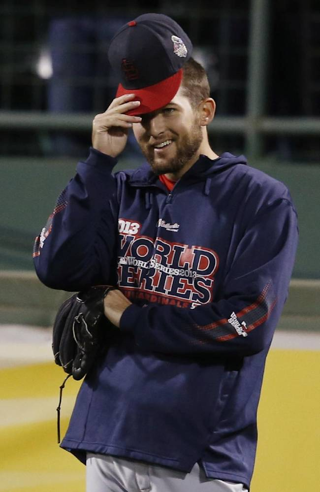 St. Louis Cardinals' Michael Wacha adjust his hat during practice before Game 1 of baseball's World Series against the Boston Red Sox Wednesday, Oct. 23, 2013, in Boston