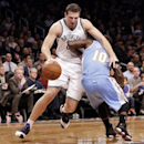Brooklyn Nets forward Mirza Teletovic, left, runs into Denver Nuggets point guard Nate Robinson (10) in the first half of an NBA basketball game Tuesday, Dec. 3, 2013, in New York The Associated Press