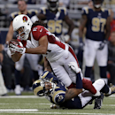 Arizona Cardinals' Larry Fitzgerald (11) is tackled by St. Louis Rams' Trumaine Johnson (22) during the second half of an NFL football game Thursday, Dec. 11, 2014 in St. Louis The Associated Press