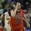Mississippi guard Marshall Henderson (22) gestures after Mississippi scored a 3-point shot during the second half of an NCAA college basketball game against the Florida in the final round of the Southeastern Conference tournament, Sunday, March 17, 2013, in Nashville, Tenn. Mississippi won 66-63. (AP Photo/John Bazemore)