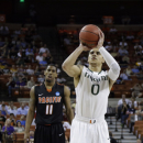 Miami's Shane Larkin (0) shoots a free throw as Pacific's Lorenzo McCloud (11) watches during the first half of a second-round game of the NCAA college basketball tournament Friday, March 22, 2013, in Austin, Texas. (AP Photo/David J. Phillip)