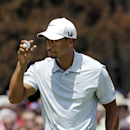 Tiger Woods acknowledges applause from the gallery after a birdie on the first hole during the third round of the Bridgestone Invitational golf tournament Saturday, Aug. 3, 2013 at Firestone Country Club in Akron, Ohio. (AP Photo/Mark Duncan)