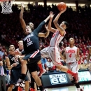 New Mexico's Kendall Williams shoots over San Diego State's James Rahon (11) and Skylar Spencer in the first half of their NCAA college basketball game in Albuquerque, N.M., Wednesday, Feb. 27, 2013. (AP Photo/ Eric Draper)