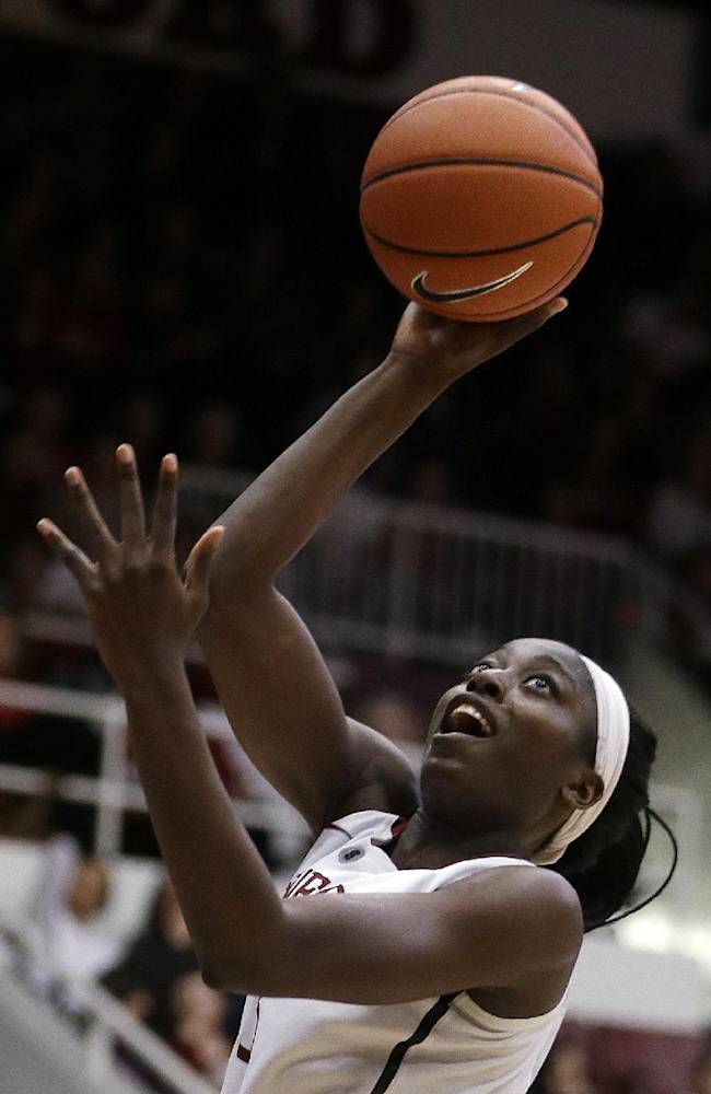 In this March 1, 2014, file photo, Stanford's Chiney Ogwumike shoots against Washington State during an NCAA college basketball game in Stanford, Calif. Ogwumike won the John R. Wooden Award on Friday night, April 11, 2014, in Los Angeles. The men's award went to Creighton's Doug McDermott