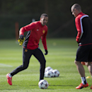 Manchester United's Rio Ferdinand, left, trains with teammates at Carrington training ground in Manchester, Tuesday, April 8, 2014. Manchester United will play Bayern Munich in Germany in a Champions League quarter final second leg soccer match on Wednesd