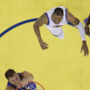 Los Angeles Clippers' Blake Griffin, bottom dunks past Golden State Warriors' Andre Iguodala during the first half in Game 3 of an opening-round NBA basketball playoff series on Thursday, April 24, 2014, in Oakland, Calif. Los Angeles won 98-96 The Associ