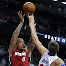 Miami Heat forward Michael Beasley (8) shoots against Detroit Pistons forward Jonas Jerebko (33), of Sweden, during the second half of an NBA basketball game on Friday, March 28, 2014, in Auburn Hills, Mich. The Heat defeated the Pistons 110-78 The Associ