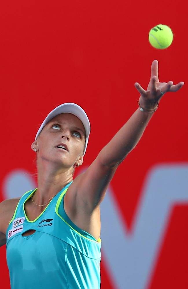 Karolina Pliskova of Czech Republic serves during the semifinals match against Alison Van Uytvanck of Belgium at the Hong Kong Tennis Open Saturday, Sept. 13, 2014. Pliskova won 6-1, 4-6, 6-4
