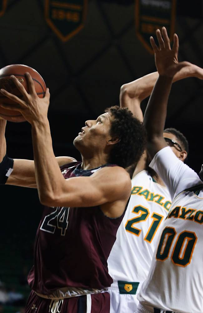 South Carolina's Michael Carrera (24), left, shoots past Baylor's Royce O'Neale (0) and Issiah Austin (21), center, in the first half of an NCAA college basketball game, Tuesday, Nov. 12, 2013, in Waco, Texas