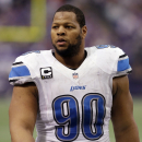 File- This Dec. 29, 2013, file photo shows Detroit Lions defensive tackle Ndamukong Suh walking on the field during the first half of an NFL football game against the Minnesota Vikings in Minneapolis. A person familiar with the situation says Suh is not attending the Detroit Lions' voluntary minicamp this week. The person, who says Suh will attend the team's voluntary workouts in May and mandatory minicamp next month, spoke Monday April 21, 2014, to The Associated Press on condition of anonymity because Suh was not announcing his plans. (AP Photo/Jim Mone, File)