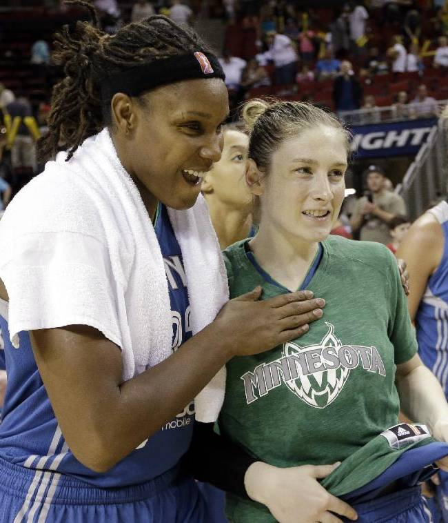 Minnesota Lynx's Rebekkah Brunson, second left, and Lindsay Whalen smile after the team beat the Seattle Storm in a WNBA basketball game Tuesday, Sept. 10, 2013, in Seattle. The Lynx won 73-60
