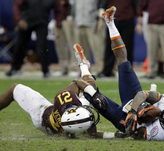 Syracuse wide receiver Brisly Estime, right, is tackled by Minnesota defensive back Brock Vereen (21) during the second half of the Texas Bowl NCAA college football game on Friday, Dec. 27, 2013, in Houston. Syracuse won 21-17
