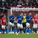 Leicester's Marcin Wasilewski, centre right, celebrates with teammates after scoring against Manchester United during the English Premier League soccer match between Manchester United and Leicester at Old Trafford Stadium, Manchester, England, Saturday Ja
