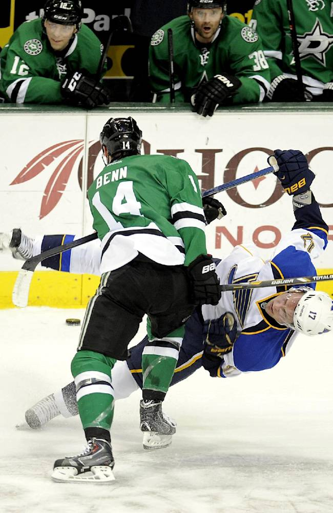 Dallas Stars left wing Jamie Benn (14) checks St. Louis Blues center Vladimir Sobotka (17) in front of the Stars bench during the first period of an NHL hockey game, Sunday, Dec. 29, 2013, in Dallas
