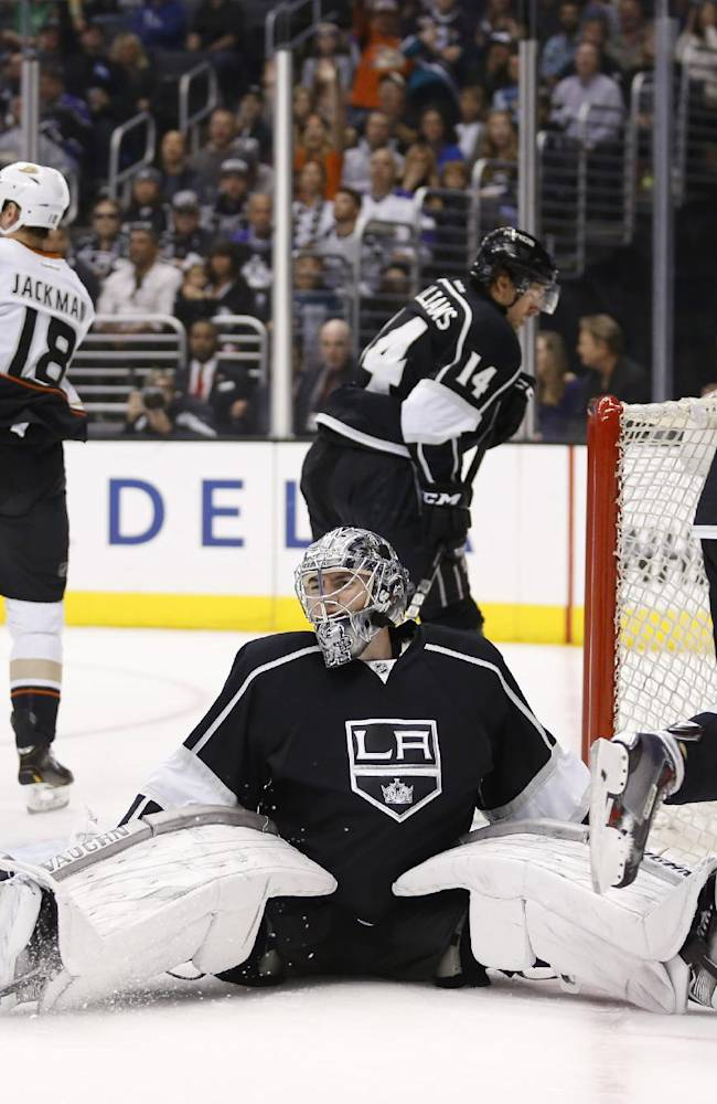 Los Angeles Kings goalie Martin Jones reacts after giving up a goal to Anaheim Ducks right wing Tim Jackman, rear left, as Los Angeles Kings right wing Justin Williams, top center, and Kings defenseman Jake Muzzin , right, skate by during the first period of an NHL hockey game in Los Angeles, Saturday, March 15, 2014