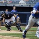 San Diego Padres catcher Nick Hundley makes a play on a ball hit by Kansas City Royals' Norichika Aoki during the second inning of a spring exhibition baseball game Wednesday, March 26, 2014, in Peoria, Ariz The Associated Press