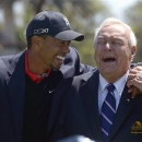 Tiger Woods, left, and Arnold Palmer share a laugh during the trophy presentation after Woods won the Arnold Palmer Invitational golf tournament in Orlando, Fla., Monday, March 25, 2013. (AP Photo/Phelan M. Ebenhack)