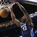 Charlotte Bobcats forwrd Anthony Tolliver (43) dunks in the first quarter of an NBA basketball game against the Oklahoma City Thunder in Oklahoma City, Sunday, March 2, 2014. Oklahoma City won 116-99 The Associated Press