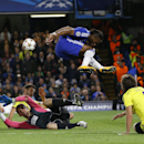 10ThingstoSeeSports - Chelsea's Didier Drogba, top, leaps over Maribor's goalkeeper Jasmin Handanovic, second left, during the Champions League Group G soccer match between Chelsea and NK Maribor at Stamford Bridge stadium in London Tuesday, Oct. 21, 2014