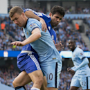 Manchester City's Edin Dzeko, left, fights for the ball against Chelsea's Diego Costa during their English Premier League soccer match at the Etihad Stadium, Manchester, England, Sunday Sept. 21, 2014