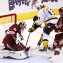 Nashville Predators' Olli Jokinen (13), of Finland, scores a goal against Arizona Coyotes' Mike Smith (41) as Coyotes' Michael Stone (26) defends during the third period of an NHL hockey game Thursday, Dec. 11, 2014, in Glendale, Ariz. The Predators defe