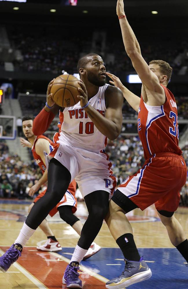 Detroit Pistons power forward Greg Monroe (10) is defended by Los Angeles Clippers power forward Blake Griffin (32) during the first half of an NBA basketball game in Auburn Hills, Mich., Monday, Jan. 20, 2014