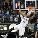 Minnesota Timberwolves forward Corey Brewer swings on the rim after a dunk against the Indiana Pacers during the first half of their NBA basketball game, Wednesday, Feb. 19, 2014 in Minneapolis The Associated Press