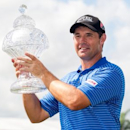 Mar 2, 2015; Palm Beach Gardens, FL, USA; Padraig Harrington celebrates winning the Honda Classic at PGA National GC Champion Course. Mandatory Credit: Peter Casey-USA TODAY