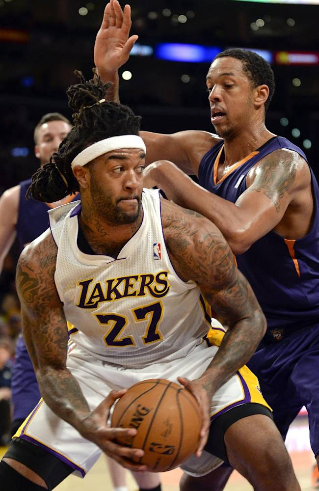 Los Angeles Lakers forward Jordan Hill (27) battles Phoenix Suns forward Channing Frye, back right, in the first half of an NBA basketball game, Sunday, March 30, 2014, in Los Angeles