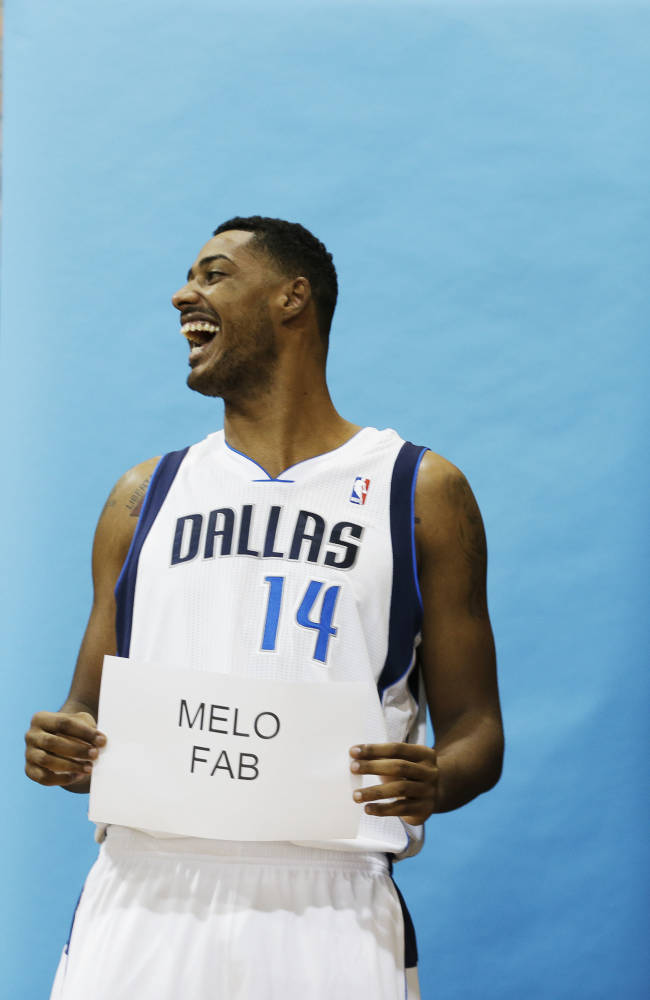 Dallas Mavericks Fab Melo (14) lets out a laugh as he poses during the basketball team's media day Monday, Sept. 30, 2013, in Dallas