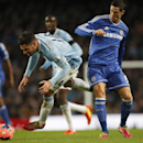 Manchester City's Javi Garcia, left is fouled by Chelsea's Fernando Torres during their English FA Cup fifth round soccer match at the Etihad Stadium, Manchester, England, Saturday, Feb. 15, 2014