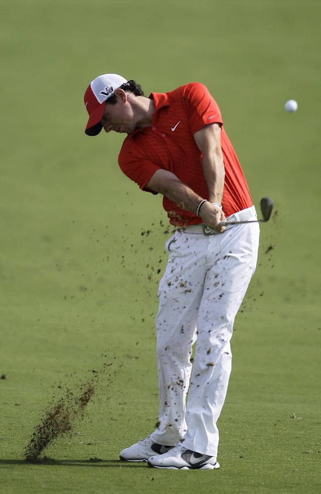 Rory McIlroy of Northern Ireland plays a ball on the first hole during the 2nd round of DP World Golf Championship in Dubai, United Arab Emirates, Friday, Nov. 15, 2013