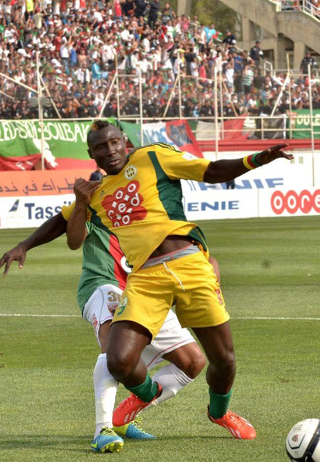 In this photo dated May 2, 2014, JS Kabylie striker Albert Ebosse of Cameroon tries to control the ball during the final of the Algerian soccer Cup in Blida near the Algerian capital, Algiers. Ebosse died after being hit in the head by an object thrown from the crowd at a top-flight league game in Algeria last August 23, 2014. Angry fans in Algeria pelted their own soccer team with rocks after they lost a game, killing the star player in the latest incident of fan violence in this North African country. Like much of the rest of the continent, Algeria's restless youth are passionate about soccer but with little other outlet for their daily frustration, violence haunts the games. (AP Photo)