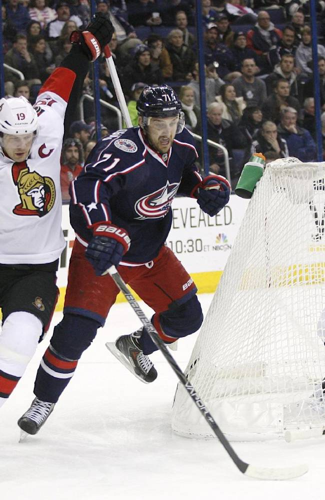 Columbus Blue Jackets' Nick Foligno (71), center, tries to get past Ottawa Senators's Jason Spezza, left, to get a shot on Senators goalie Craig Anderson (41) during the second period of an NHL hockey game, Tuesday, Jan. 28, 2014, in Columbus, Ohio