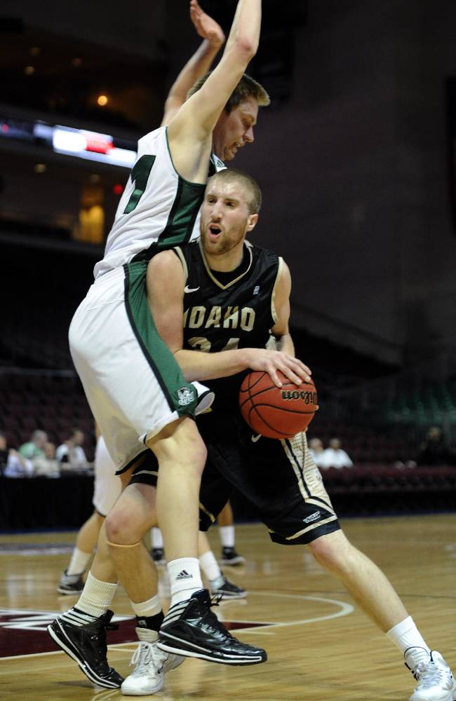 Idaho's Stephen Madison (34) is guarded by Utah Valley's Zach Nelson during the first half of an NCAA college men's basketball game in the semifinals of the West Athletic Conference tournament Friday, March 14, 2014, in Las Vegas