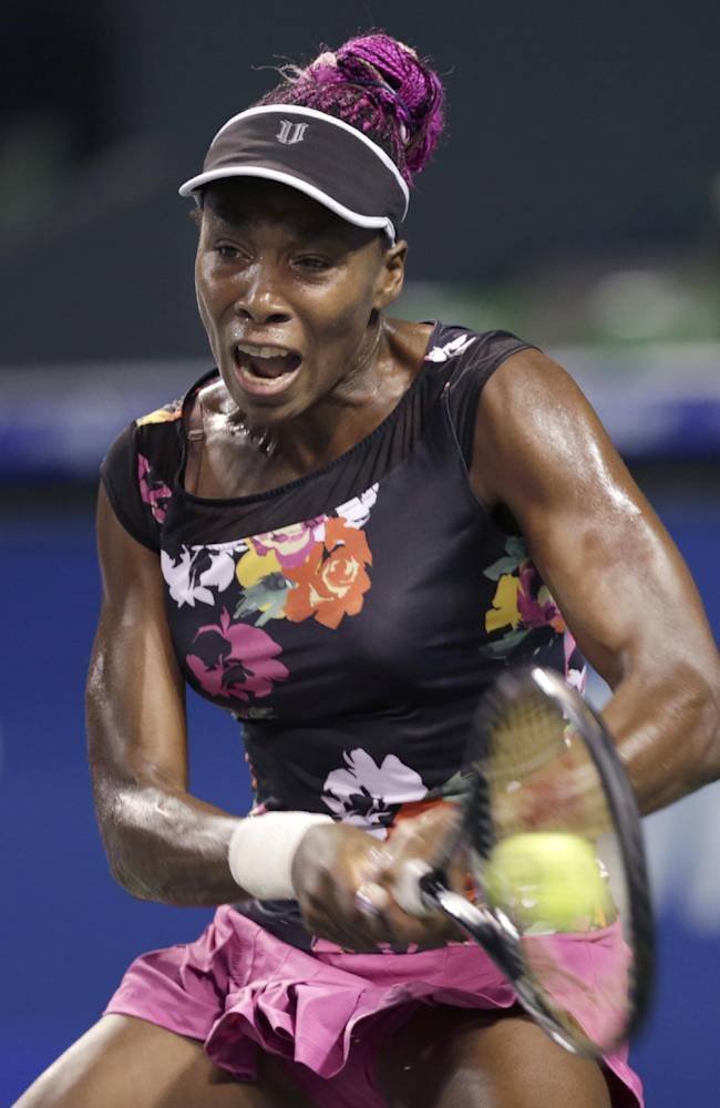 Venus Williams of the U.S. returns a shot against Eugenie Bouchard of Canada during their quarterfinal match of the Pan Pacific Open tennis tournament in Tokyo, Thursday, Sept. 26, 2013
