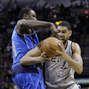 San Antonio Spurs' Tim Duncan (21) is pressured by Dallas Mavericks' Samuel Dalembert (1) during the first half of an NBA basketball game, Sunday, March 2, 2014, in San Antonio The Associated Press