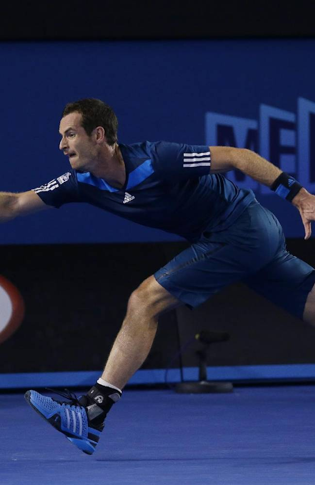 Andy Murray of Britain makes a forehand return to Vincent Millot of France during their second round match at the Australian Open tennis championship in Melbourne, Australia, Thursday, Jan. 16, 2014