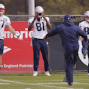 New England Patriots tight ends Rob Gronkowski (87), Timothy Wright (81) and wide receiver Danny Amendola (80) stretch before practice begins at the NFL football team's facility Wednesday, Oct. 29, 2014 in Foxborough, Mass. The Patriots (6-2) will play th