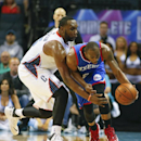 Philadelphia 76ers guard James Anderson, right, works to control the ball as Charlotte Bobcats center Al Jefferson, left, plays defense during the second half of an NBA basketball game in Charlotte, N.C., Saturday, April 12, 2014 The Associated Press