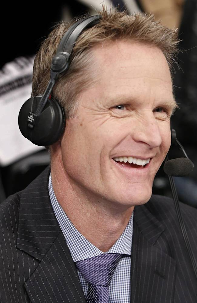 TNT commentator and former Chicago Bulls and San Antonio Spurs guard Steve Kerr broadcasts courtside for Game 4 of an NBA basketball first-round playoff series between the Toronto Raptors and the Brooklyn Nets at the Barclays Center, Sunday, April 27, 2014, in New York.  New York Knicks President Phil Jackson told reporters he interviewed Kerr for the vacant  New York Knicks coaching position