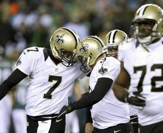 New Orleans Saints' Luke McCown (7) celebrates with Shayne Graham (3) after Graham's field goal during the first half of an NFL wild-card playoff football game against Philadelphia Eagles, Saturday, Jan. 4, 2014, in Philadelphia