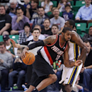 Portland Trail Blazers' LaMarcus Aldridge (12) drives on Utah Jazz's Jeremy Evans, right, in the first quarter during an NBA basketball game Monday, Dec. 9, 2013, in Salt Lake City The Associated Press