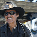 Car owner and former Hall of Fame driver Richard Petty stands outside his hauler in the garage area during qualifying for the NASCAR Daytona 500 auto race at Daytona International Speedway in Daytona Beach, Fla., Sunday, Feb. 16, 2014. (AP Photo/Phelan M. Ebenhack)