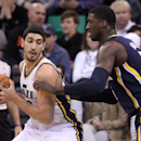 Indiana Pacers' Roy Hibbert, right, defends against Utah Jazz's Enes Kanter, left, of Turkey, in the first quarter during an NBA basketball game Wednesday, Dec. 4, 2013, in Salt Lake City The Associated Press