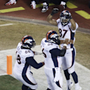 Denver Broncos wide receiver Eric Decker (87) celebrates a touchdown with center Manny Ramirez (66) and guard Zane Beadles (68) during the second half of an NFL football game, Sunday, Dec. 1, 2013, in Kansas City, Mo The Associated Press